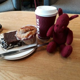 Jo dragon enjoying coffee and cake